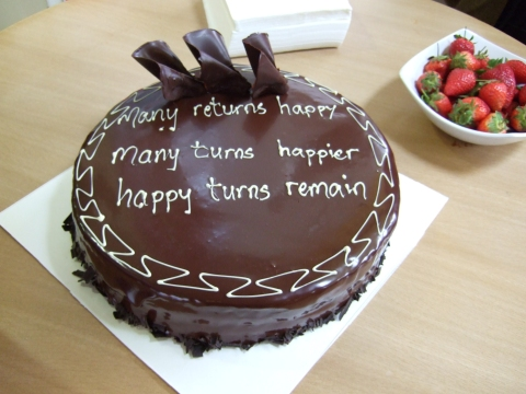 Many returns happy/ Many turns happier/ Happy turns remain: first three lines of 'The Computer's First Birthday Card' on EM's birthday cake