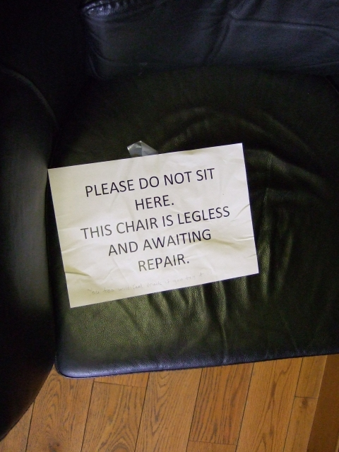 Please do not sit here. This chair is legless and awaiting repair.